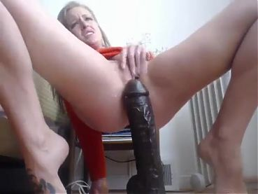 Olesya fucks herself with a big dildo.