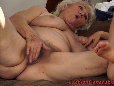Lesbian babe masturbating with mature
