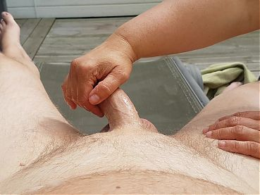 Wife give handjob on our veranda.